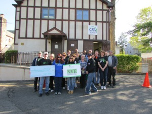 •Team NVE Presents Rebuilding Together Bergen County with a check for $6,000