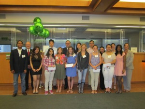 NVE Bank executives stand with the high school and middle school recipients who received scholarships at the Bank's Englewood headquarters during a celebratory reception.